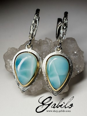 Silver earrings with a larimar