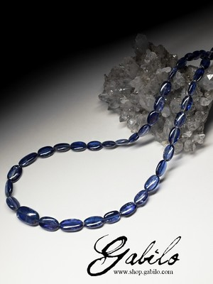Beads from kyanite with a golden lock