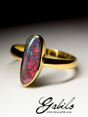 Golden ring with black opal