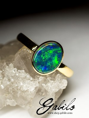 On order: gold ring with black opal