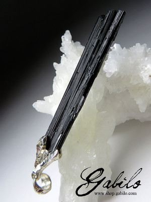 Crystal of black tourmaline on a cord