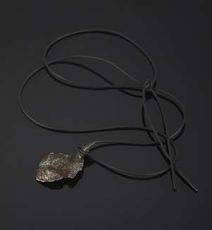 Pendant from meteorite-individual on rubber