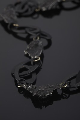 Necklace of meteorites on a large chain