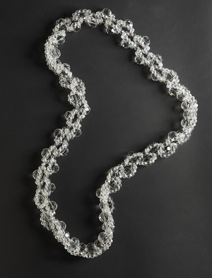 Long necklace of transparent glass beads