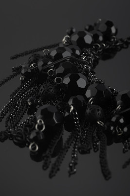 A short necklace made of metal chains and glass beads