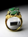 Ring with emeralds in gold
