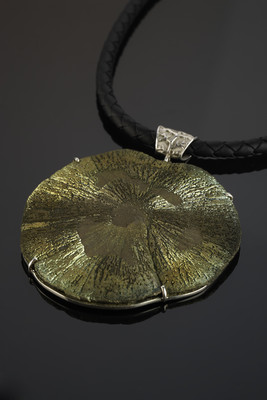 Decoration with a pyrite nodule in silver