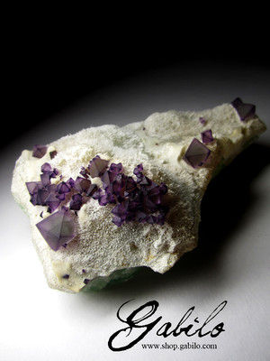 Violet fluorite on the rock