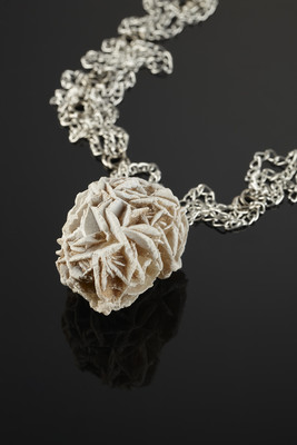 Pendant with a desert rose