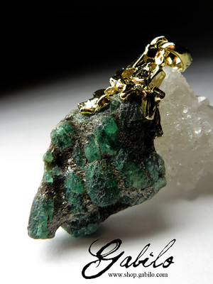 Emeralds in gold pendant