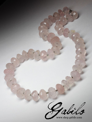 Large beads of pink quartz cut