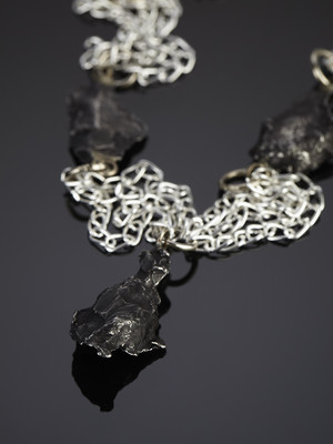 Decoration of 3 meteorites on white chains