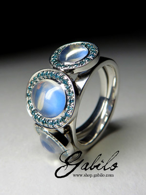 Moonstones gold ring with blue diamonds