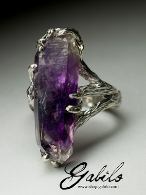 Silver ring with amethyst crystal