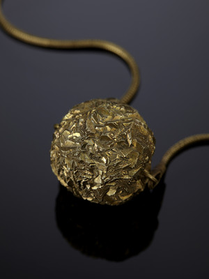 Pendant with a pyrite rose on a bronze cord