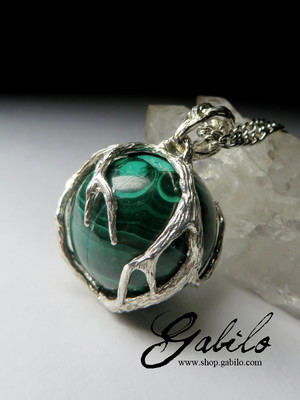 A ball of malachite in silver