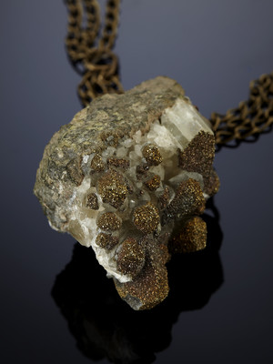 Spectropyrite on calcite on bronze chains