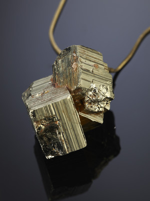 Cubic pyrite crystal on a bronze cord