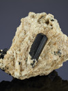 Crystal black tourmaline on the rock