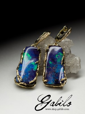 Gold earrings with bright boulder opal