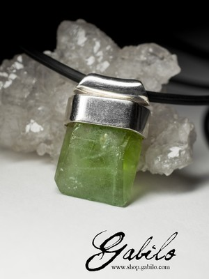 Silver pendant with chrysolite on rubber