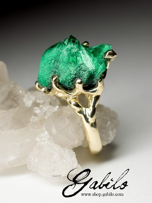 On order: a gold ring with plastique malachite