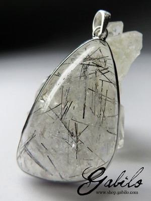 Silver pendant with rutilated quartz