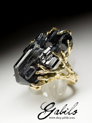 A large gold ring with a black tourmaline