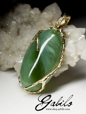 On order: a gold pendant with jade