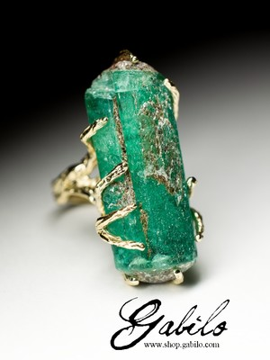 A large ring with an emerald in gold